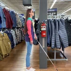 Blind person with cane at retail store with Vertical Extension